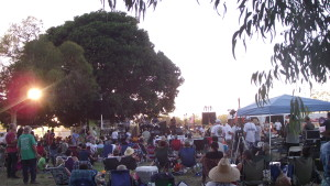 The crowd thickens as the sun sets during Laurie Morvan's set, day 2 of the festival.